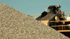 Sand falling from conveyor belt on pile.Separation of sand.Construction industry - stock footage