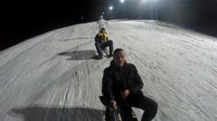 Stock Video Footage of 4K Winter fun, snow, family sledding at winter night time. UHD stock video