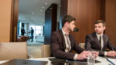 Business with colleagues in meeting room Stock Footage