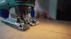 A machine cutting the piece of wood veneer. Close-up. Pan shot Stock Footage