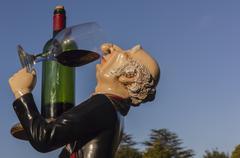 Doll Butler Drinker - stock photo