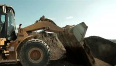 Bulldozer pouring sand on pile,separation of sand,excavator on construction site Stock Footage