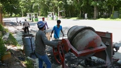 Сonstruction concrete cement mixer workers Stock Footage