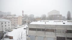 Snow-covered roofs of city buildings - stock footage