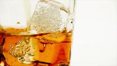 Close-up pouring whiskey on white background, whisky relax time Stock Footage