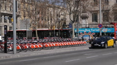 El Bicing - Barcelona city bicycles with Traffic on Passeig de Colom Stock Footage