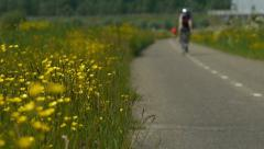 Buttercups and bicyclists Stock Footage