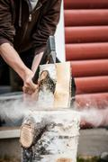Wood chopping with hand axe Stock Photos