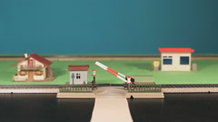 Railroad crossing with passing train Stock Footage