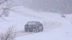 Car Driving In A Snow Storm Stock Footage