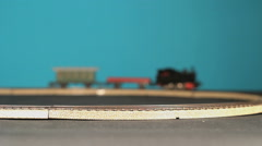 Locomotive with wagons is taking a corner on a train track Stock Footage