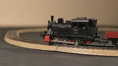 Locomotive is taking a corner on a train track - stock footage