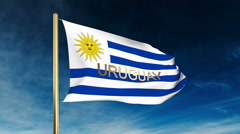Uruguay flag slider style with title. Waving in the wind with cloud background Stock Footage