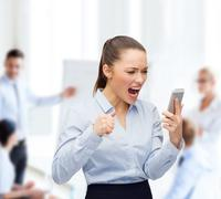 Screaming businesswoman with smartphone Stock Photos
