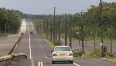 Cars pass by the countryside road in Grand Bassin, Mauritius. Stock Footage