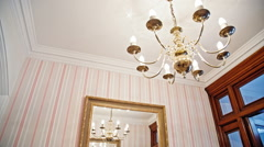 English interior with expensive lamp and mirror on wall Stock Footage