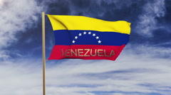 Venezuela flag with title waving in the wind. Looping sun rises style Stock Footage