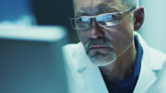Serious and Focused Scientist Working on Computer - stock footage