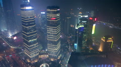 Shanghai skyscraper business district at night - stock footage