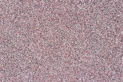 Multicolored natural marble chip plaster close-up background Stock Photos
