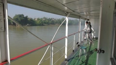 Tourists watching the scenery on the slow boat,Irrawaddy,Burma Stock Footage