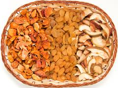 a mixture of dried fruits in a basket - stock photo