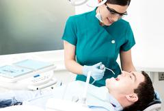 Stock Photo of Professional dentist doing dental checkup