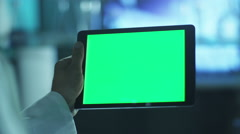 Using Tablet with Green Screen in Landscape Mode. Scientific Environment. Stock Footage