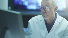 Scientist is Works on Computer in Laboratory, Jib shot. Stock Footage