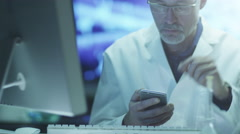 Scientist is Using Mobile Phone in Laboratory Stock Footage