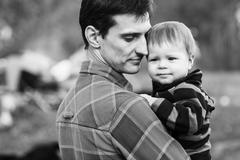 Father and son outdoors - stock photo