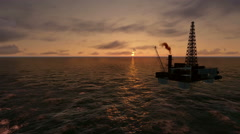 Sunset and Oil Rig in the Ocean Stock Footage