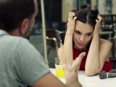 Young woman getting annoyed from her boyfriend in cafe  - stock footage