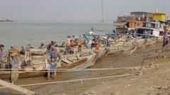 Laborers unload sand at Mandalay,Mandalay,Burma Stock Footage