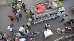 Loading of mini bus seen from above,Mandalay,Burma Stock Footage