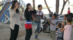 Teachers teach children at Mandalay beach village,Mandalay,Burma - stock footage