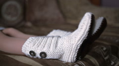 legs of woman in white knit socks are moving to the music - stock footage