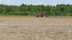 Agriculture tractor ploughing soil spring field Stock Footage
