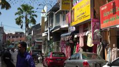 People talk in street in Little India, George Town, Penang, Malaysia Stock Footage