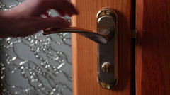 woman opens and closes the door in the room - stock footage