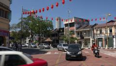 Traffic drives along Chulia street, George Town, Penang, Malaysia Stock Footage