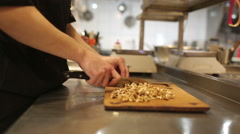 Cook man, chopped walnuts - stock footage