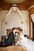 Newly married couple in hotel room, romance wedding night Stock Photos