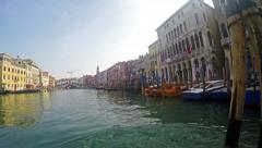Stock Video Footage of 4K view of Grande Canal with Rialto bridge at background in Venice Italy