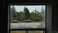 View through broken window of destroyed motel room. Cars passing. Stock Footage