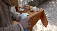 Spain Mallorca Island Sineu village 030 on a market, hands work on soapstone Stock Footage