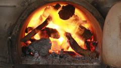 fire burning firewood in big kiln (3 shot) - stock footage