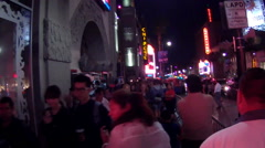 POV Walking Crowded Hollywood Blvd With Tourists- Night Stock Footage