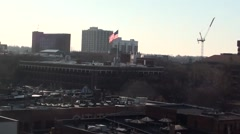 Skyline, Rooftop shot Ann Arbor, Michigan, USA with U.S. Flag waving Stock Footage