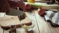 Garlic squeeze - Mash fresh garlic in press - closeup Stock Footage